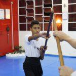Treino de luta combinada com bastões no Shaolin do Norte